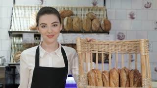 The girl seller offers bread