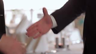 The men shake hands