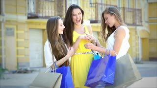 Three cute girls meet while shopping, and consider buying fashion