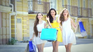 Three graceful cute girl happily walking with fashionable shopping while shoppin