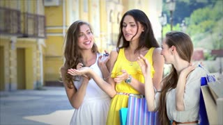 Three young beautiful girls discuss the Fashion Shop