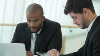 Two successful businessman in the office focused work