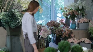 Two women come into flower shop