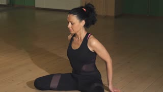 Beautiful woman stretching her body practicing yoga indoors flexible flexibility body care health healthy lifestyle workoing out exercising active hobby recreation muscles asana.