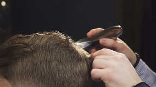 Cropped close up of the hands of a professional barber cutting hair of a client using trimmer or clipper profession occupation skillful stylist fashion barbershop job professionalism barbering