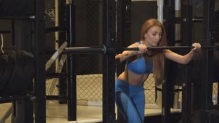 Shot of a beautiful sexy sportswoman exercising at the gym doing squats with a barbell fitness activity lifestyle motivation sports athletic toning buttocks shaping bodybuilding