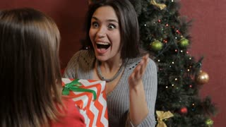 Woman gets christmas gift from her daughter
