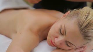 Woman on spa massage of shoulder