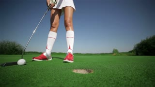 Woman plays golf at the golf club