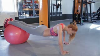Woman push-ups at the fitness centre