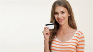 Woman showing thumbs-up with credit card