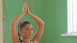 Young brunette girl practising yoga
