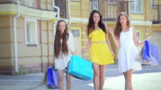 Young cheerful girl walking shopaholic shopping with shopping bags