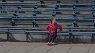 Young girl doing gymnastics exercise