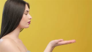 Young woman looks at her hands