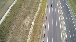 Aerial view of cars driving along empty country road in Germany