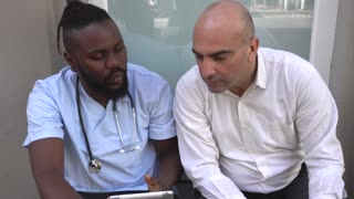 African american doctor giving patient good news and explaining positive results. Handshake