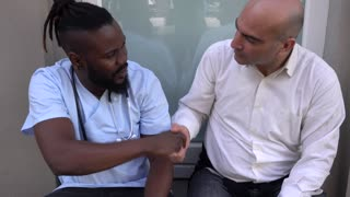 African american doctor shaking patient's hands