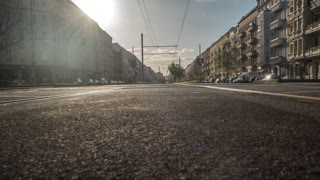 Berlin, Germany - April 20, 2016: big boulevard of the center of the city, with cars, streetcar, bicycles and pedestrians. Time-lapse