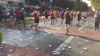 Berlin, Germany - September 25, 2016: time lapse of back turned marathon athletes running