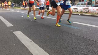 Berlin, Germany - September 25, 2016: time lapse of marathon athletes running in city centre