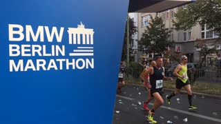 Berlin, Germany - September 25, 2016: time lapse of marathon athletes running. On foreground marathon logo
