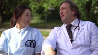 Doctors during work break in park