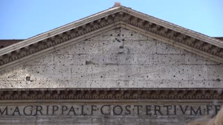Facade of Pantheon in Rome. Tilting from above. The Pantheon is a former Roman temple on the site of an earlier temple commissioned by Marcus Agrippa during the reign of Augustus (27 BC – 14 AD)