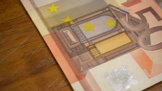Fifty Euro cash money tracking shot