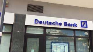 Rome, Italy - July 5, 2016: Deutsche Bank sign outside a branch. It is a German global banking and financial services company with its headquarters in Frankfurt