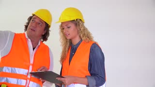 Senior engineer teaching to young cute female trainee. White background