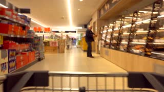 Time lapse clip of shopping cart in supermarket. Shopping cart point of view. Hyperlapse