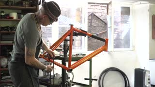 Time lapse: technician creating bicycle in repair shop
