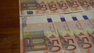 Tracking shot of 50 Euro currency