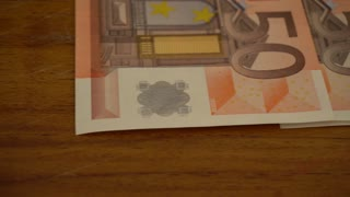 Tracking shot of fifty Euro cash money