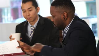 Asian and African American white collar workers working together in office