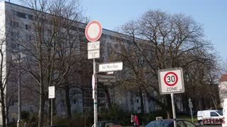 Berlin, Germany - April 5, 2018: Karl-Marx-Allee street name sign, monumental socialist boulevard built by the GDR between 1952 and 1960 in Berlin Friedrichshain and Mitte