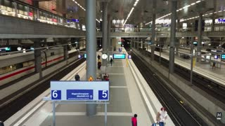 Berlin, Germany - February 13, 2018: Berlin DB Deutsche Bahn Hauptbahnhof railway platform viewed from a moving sliding scale