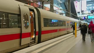 Berlin, Germany - February 16, 2018: DB Deutsche Bahn stationary train waiting at platform. Deutsche Bahn AG is a German railway company. The company carries about two billion passengers each year