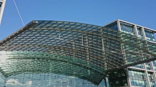 Berlin, Germany - February 26, 2018: Glass facade of the DB Deutsche Bahn Hauptbahnhof, the main railway station, the largest train station in Europe
