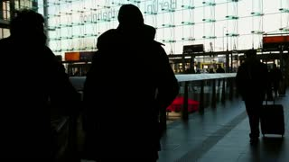 Berlin, Germany - February 6, 2018: Travellers and commuters inside the Berlin DB Deutsche Bahn Hauptbahnhof, the main railway station, the largest train station in Europe