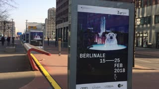 Berlin, Germany - February 7, 2018: posters of 68th Berlinale - Berlin International Film Festival 2018, in Potsdamer Platz. The bear is the symbol of the Festival