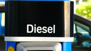 Berlin, Germany - July 23, 2018: Diesel fuel pump nozzle in an Aral petrol station. Aral is a brand of automobile fuels and petrol stations, present in Germany and Luxembourg