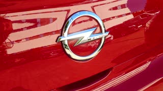 Berlin, Germany - July 23, 2018: Opel emblem on a red car. Adam Opel AG is a German automobile manufacturer headquartered in Russelsheim, Hesse, Germany. It is a subsidiary of General Motors
