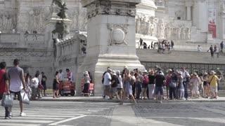 Rome, Italy - August 11, 2018: Pedestrians crossing the road in front of the Altare della Patria, in Piazza Venezia