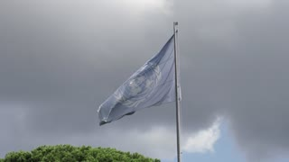Rome, Italy - September 2, 2018: FAO flag waving. Food and Agriculture Organization of the United Nations is a specialised agency of the United Nations leading international efforts to defeat hunger