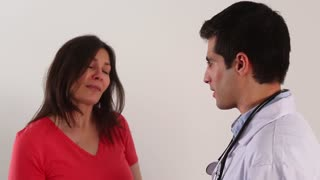 Young male doctor talking with a female patient