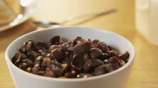 A Man Takes a Bowl with Chocolate Flakes