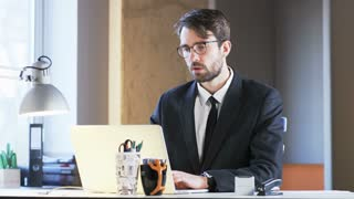 Bored Young Businessman Working Reluctantly