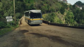 Bus Goes Through an Old Bridge in a Amazing Scenary in Madeira
